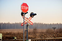 Sign Stop near railroad