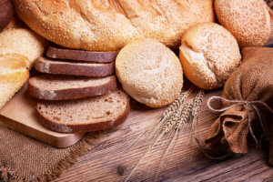OM Plus, Plus Technologies, German, Germany, Fresh bread, sweet pastries, baked goods, harvest on the farm, great food, ears of wheat, burlap sack of grain, healthy food, a table of old wood, bread closeup